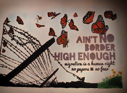 [Ain't no border high enough – mogration is a human right – no gagers – no fear]